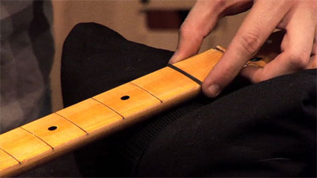 Setting a fret in a guitar fretboard with Hot Stuff CA glue
