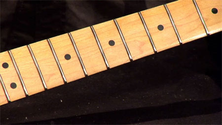 A guitar fretboard refretted and refinished with Hot Stuff CA glue