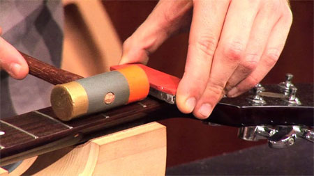 Loosening a nut on a guitar with Super Solvent CA glue debonder