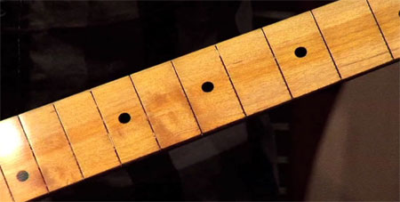 A fretboard refinished with Hot Stuff CA glue