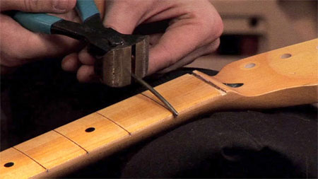 Cutting fret ends on a fretboard