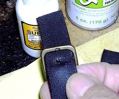A buckle set in the new hole sealed with Super T CA glue